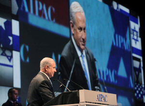Benjamin Netanyahu stands at a podium